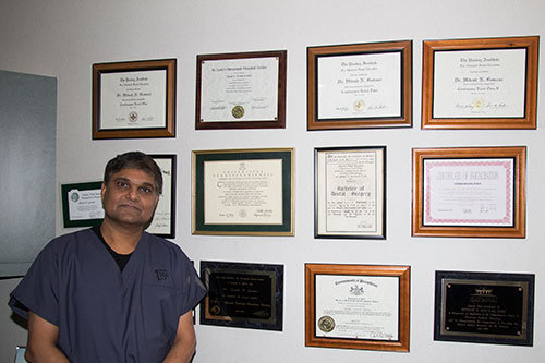 Dr. Govani with dental diplomas